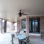 Sprawling underdeck patio with fan