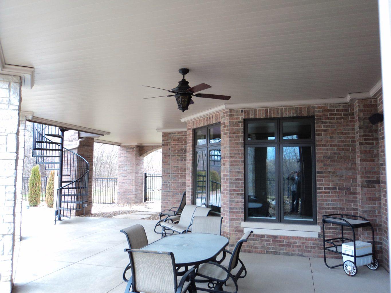 Sprawling underdeck patio with fan