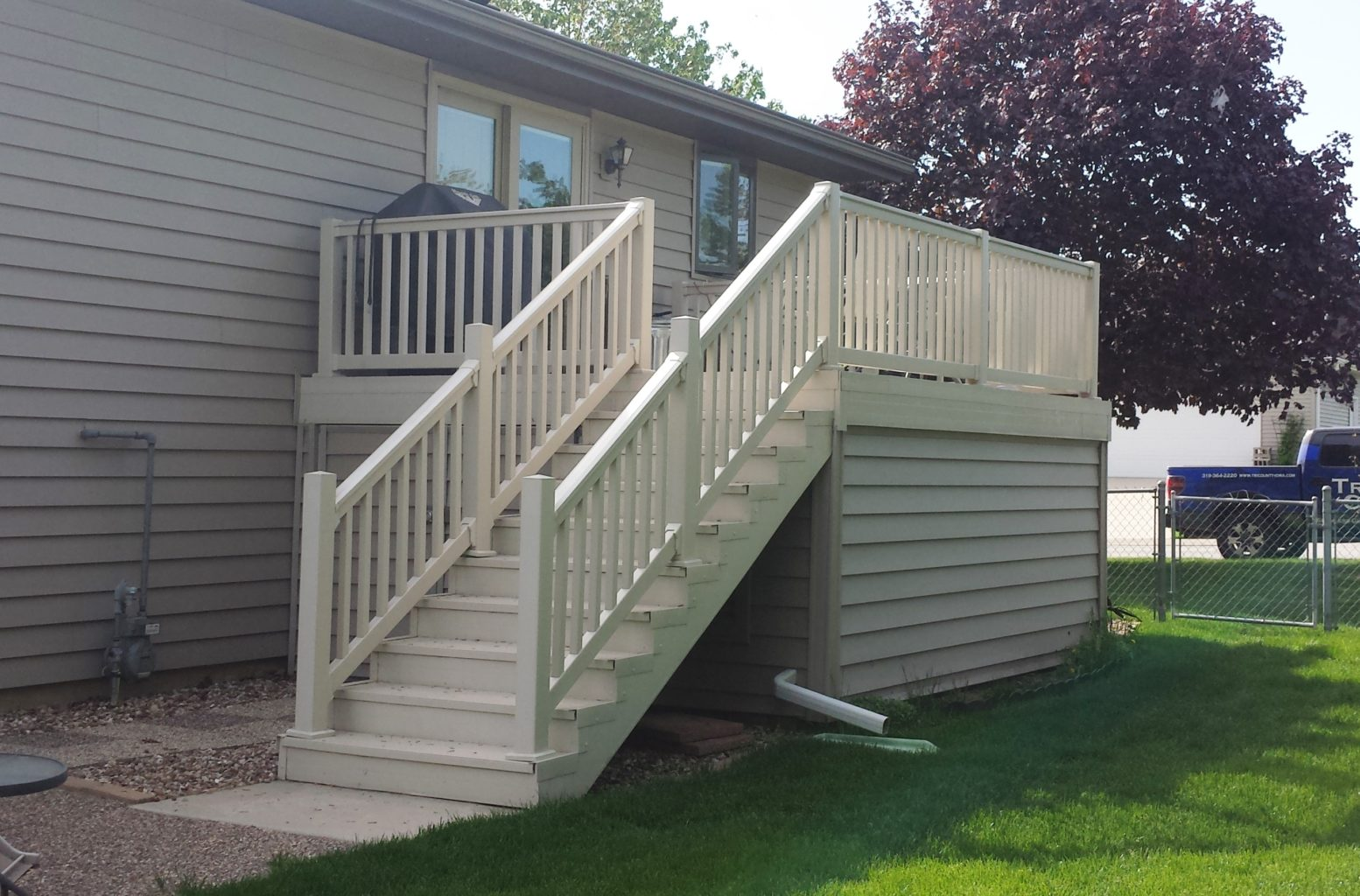 underdeck storage shed with matching siding